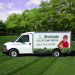 brookside lawn truck in a beautiful yard